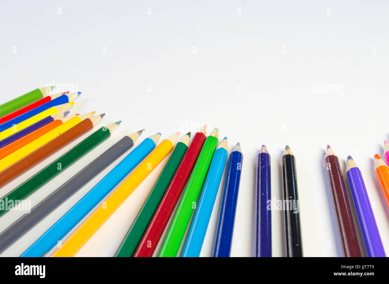 Colored pencil border on white background - Stock Image