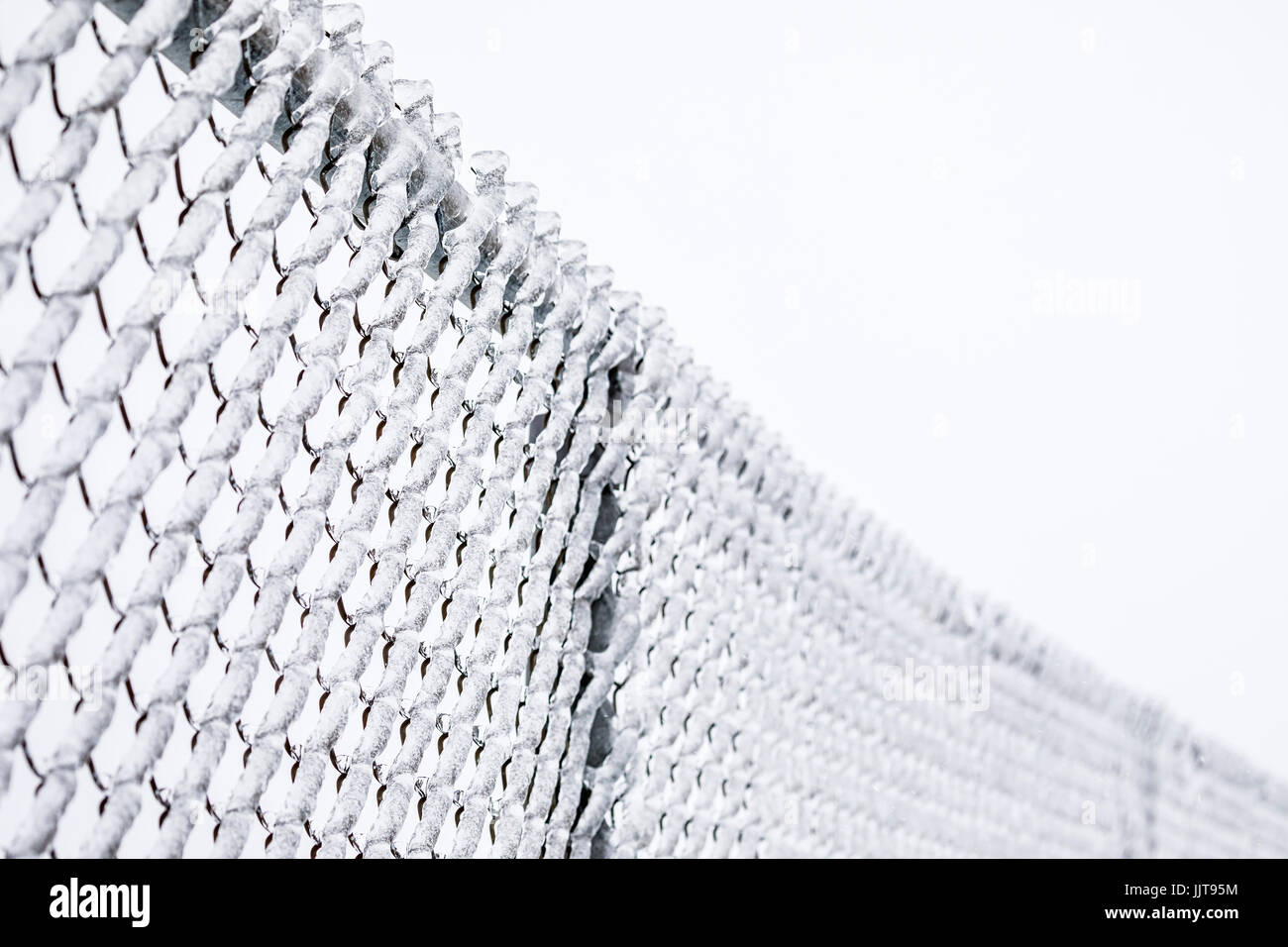 Ice covered chain link fence. - Stock Image