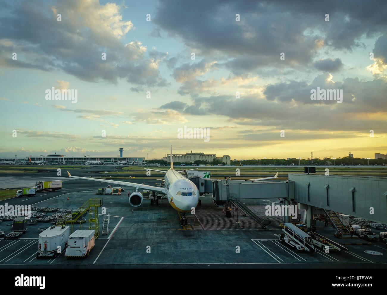 Manila, Philippines - Apr 14, 2017. A civil aircraft docks and waits at Terminal 3 of Ninoy Aquino Airport (NAIA) - Stock Image