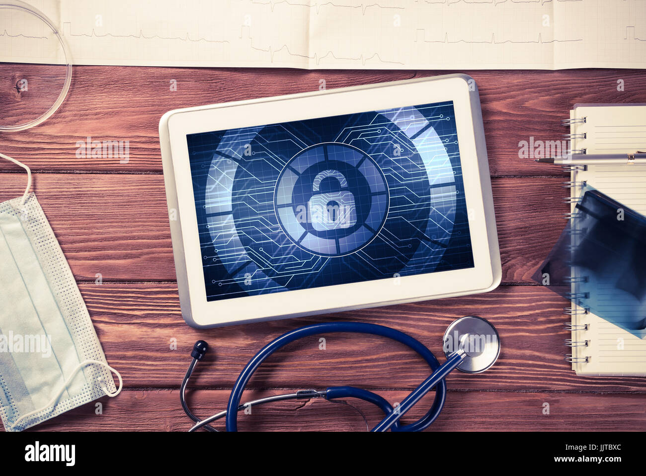 Web Security And Technology Concept With Tablet Pc On Wooden Tab