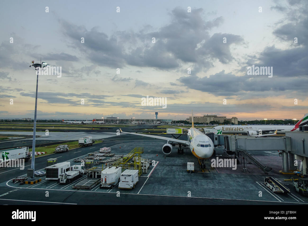 Manila, Philippines - Apr 14, 2017. A civil aircraft docks at Terminal 3 of Ninoy Aquino Airport (NAIA) in Manila, - Stock Image