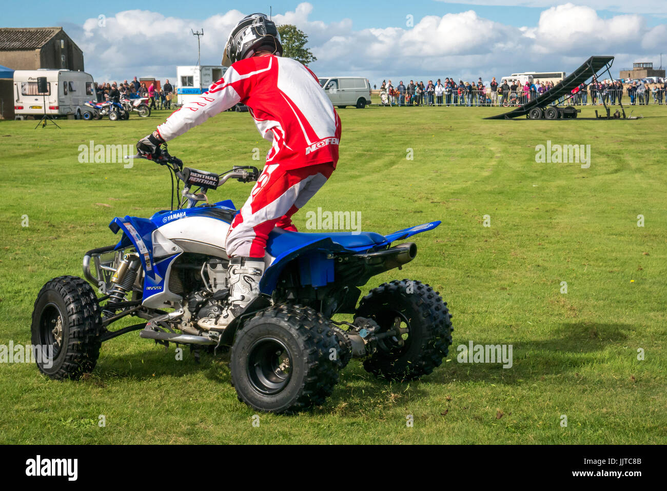 Jason Smyth stuntman performing quad bike stunt at Wheels and Wings family event 2016, East Fortune, East Lothian, Stock Photo