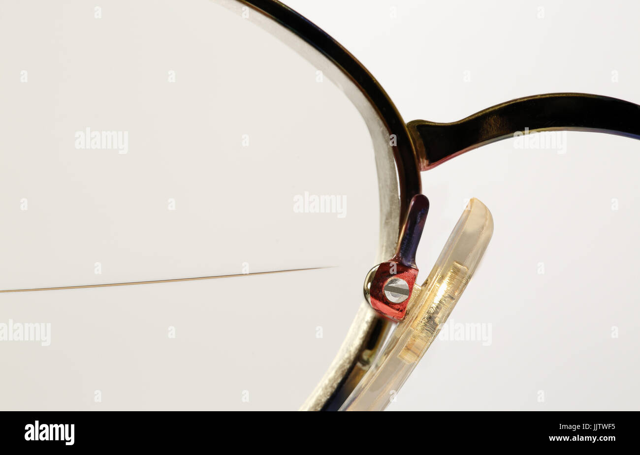 'Guess what it is' close up image, or background image, of a pair of spectacles - Stock Image
