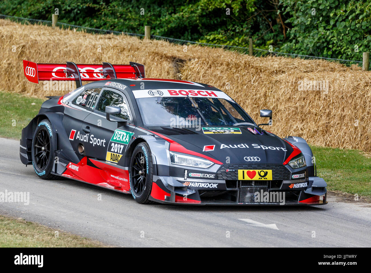 2017 Audi RS5 DTM racer with driver Tom Kristensen at the 2017 Goodwood Festival of Speed, Sussex, UK. - Stock Image