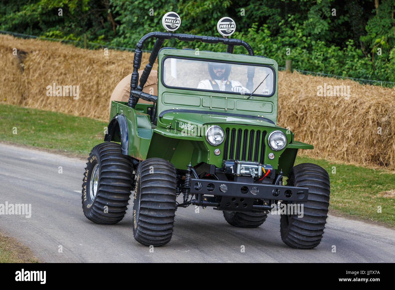 1982 Tamiya Wild Willy, the U.S. Army M23 Willys Jeep based reproduction of the toy at the 2017 Goodwood Festival - Stock Image