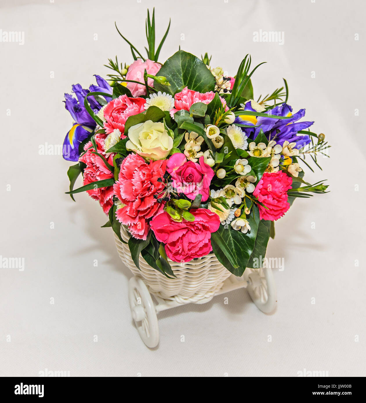 Floral Arrangement With White Bicycle And Colored Flowers Roses