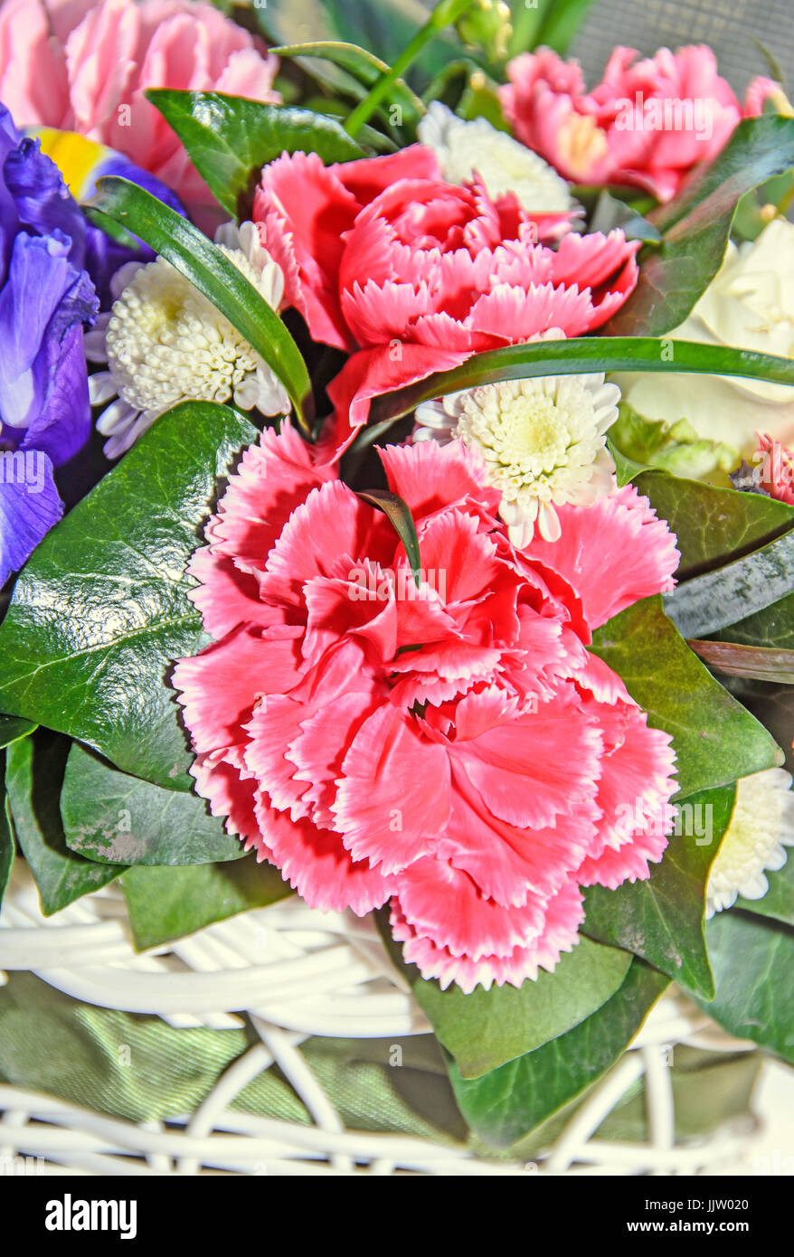 Floral arrangement with colored flowers roses, iris, chrysanthemums ...