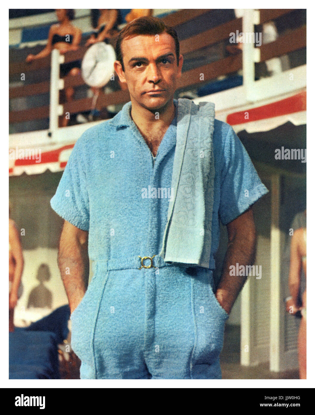 4401315614 James Bond  Goldfinger  (Sean Connery) in a blue poolside towelling jumpsuit