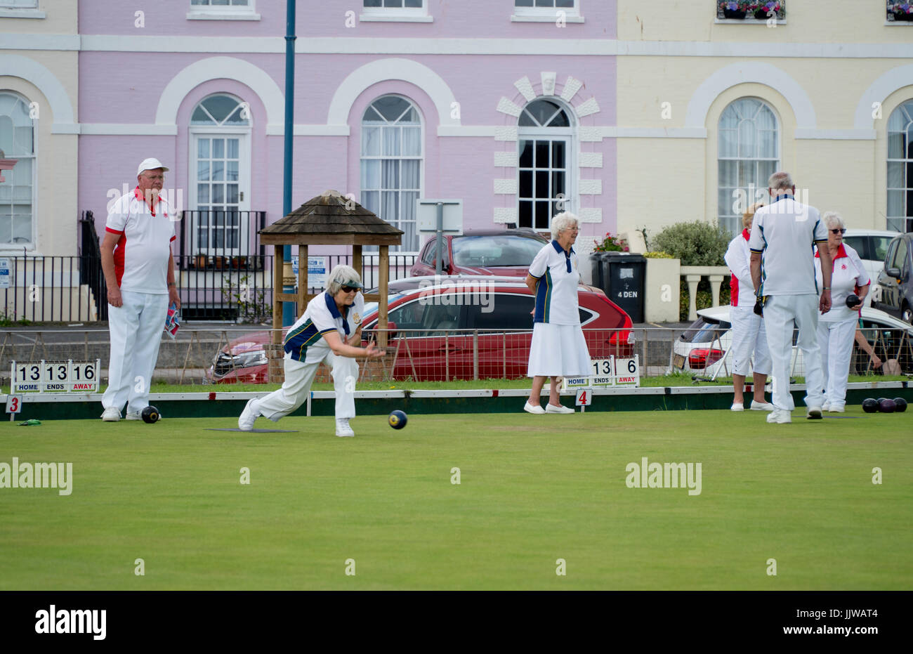 Men and women playing a game of lawn bowls in Teignmouth, Devon, England - Stock Image