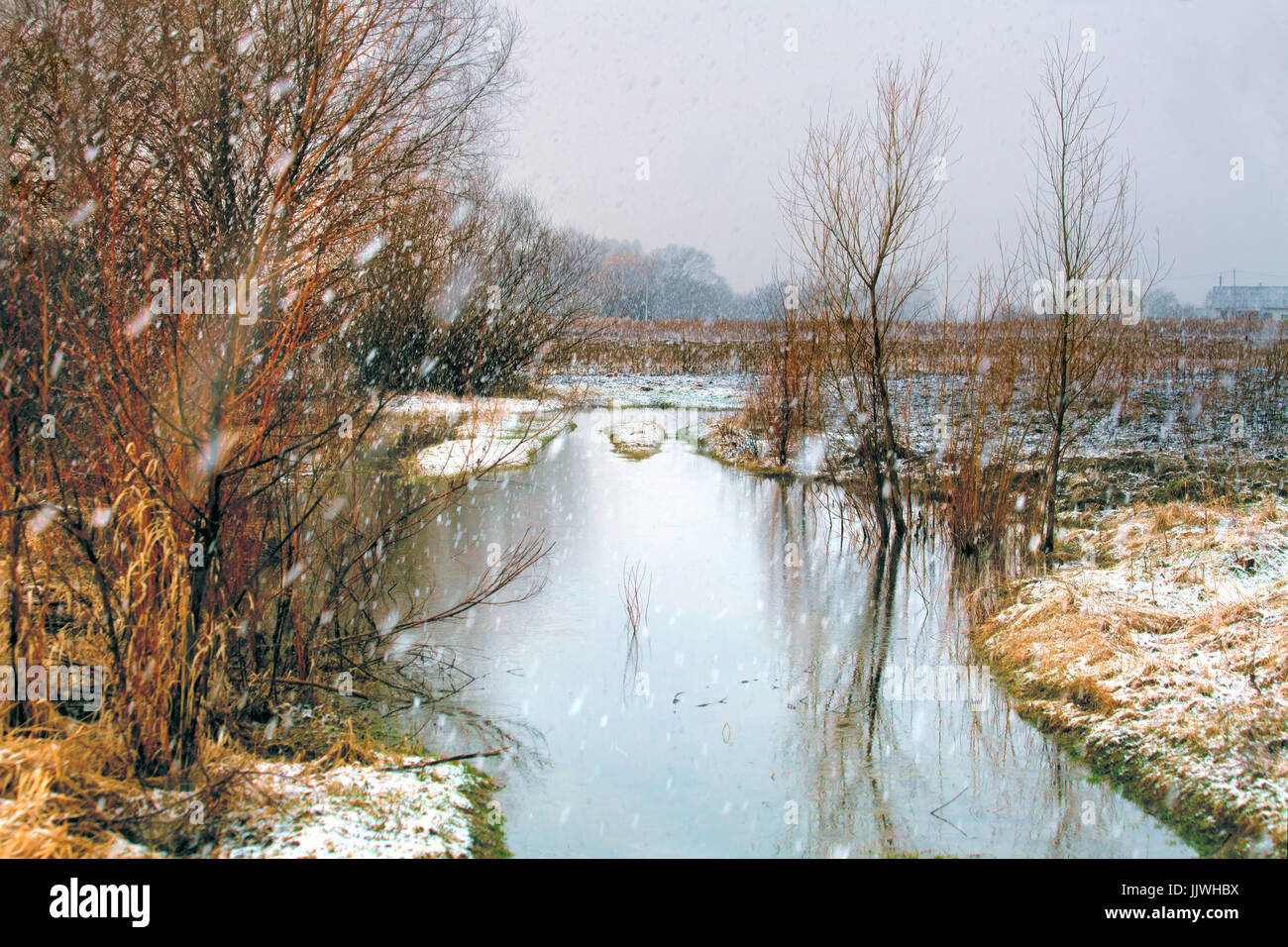 Winter river in snowy weather - Stock Image