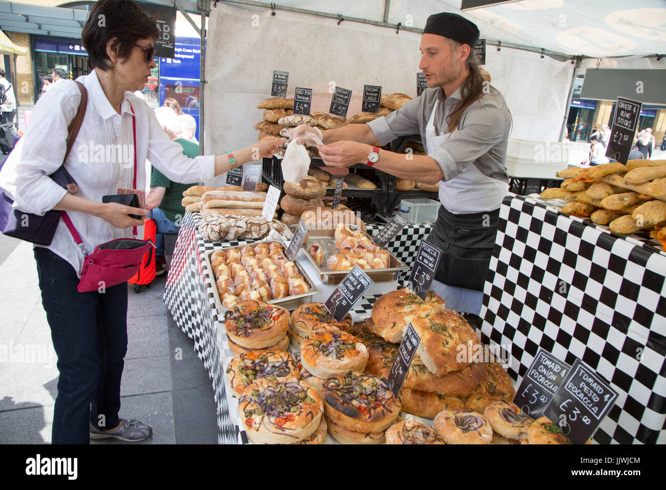 Artisan bakery stall at the Real Food Market, Kings Cross. Every Wednesday to Friday outside King's Cross Station. - Stock Image