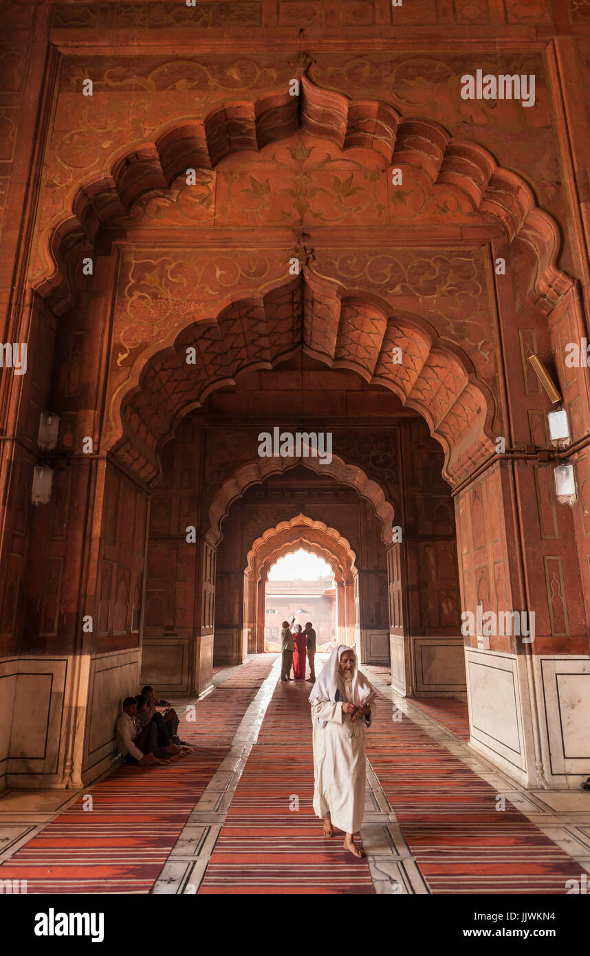Interior arches and prayer area nside the Jama Masjid mosque in Delhi, India. - Stock Image