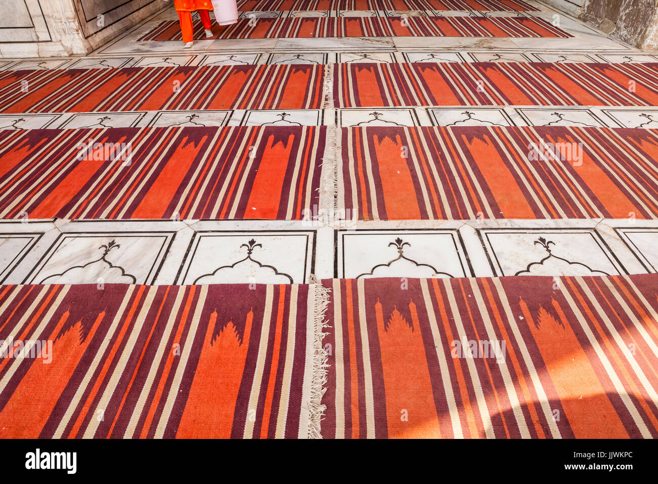 Prayer rugs inside the prayer area of Jama Masjid, one of the largest mosques in Delhi, India. - Stock Image