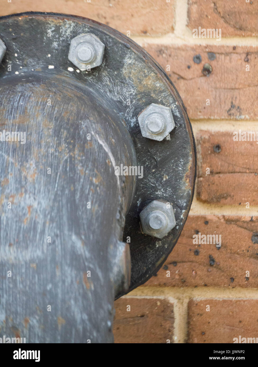industrial Pipe on Brick Wall Background - Stock Image