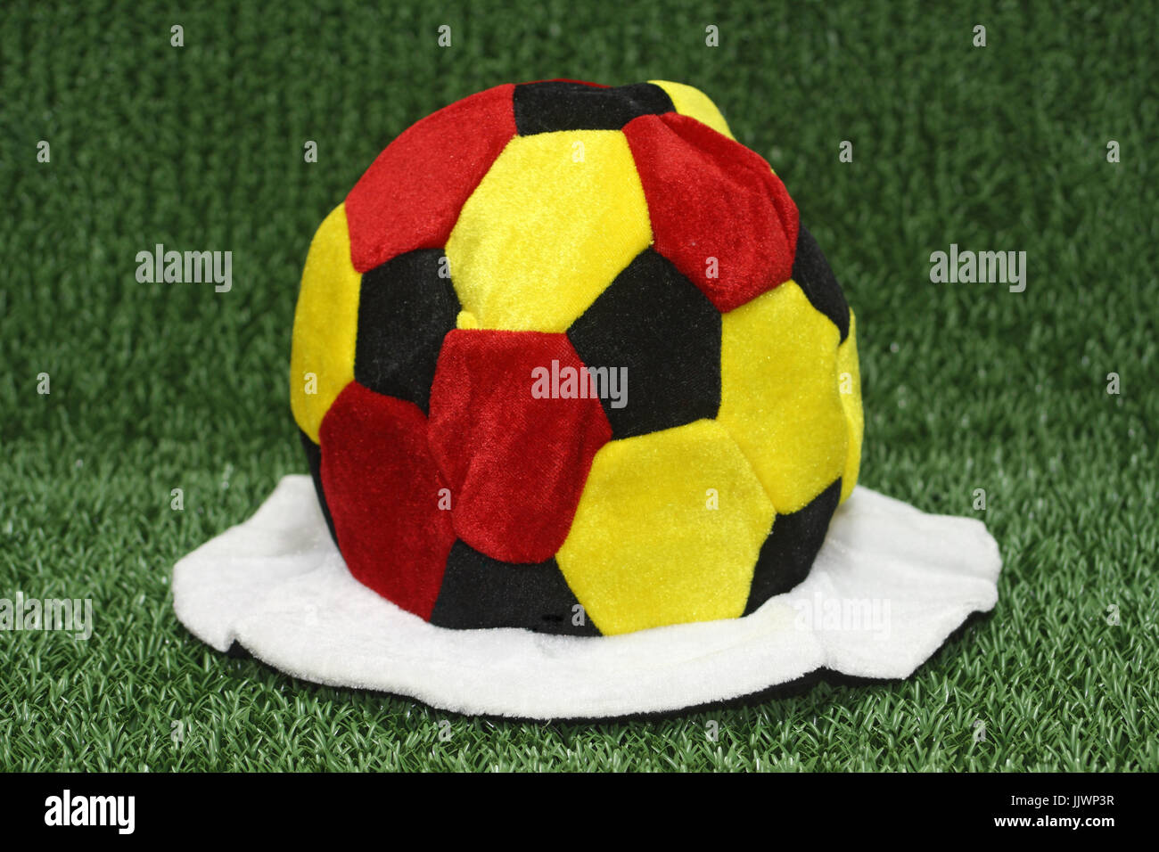 47bab3c1f0e Soccer cap in german flag colors on green background Stock Photo ...