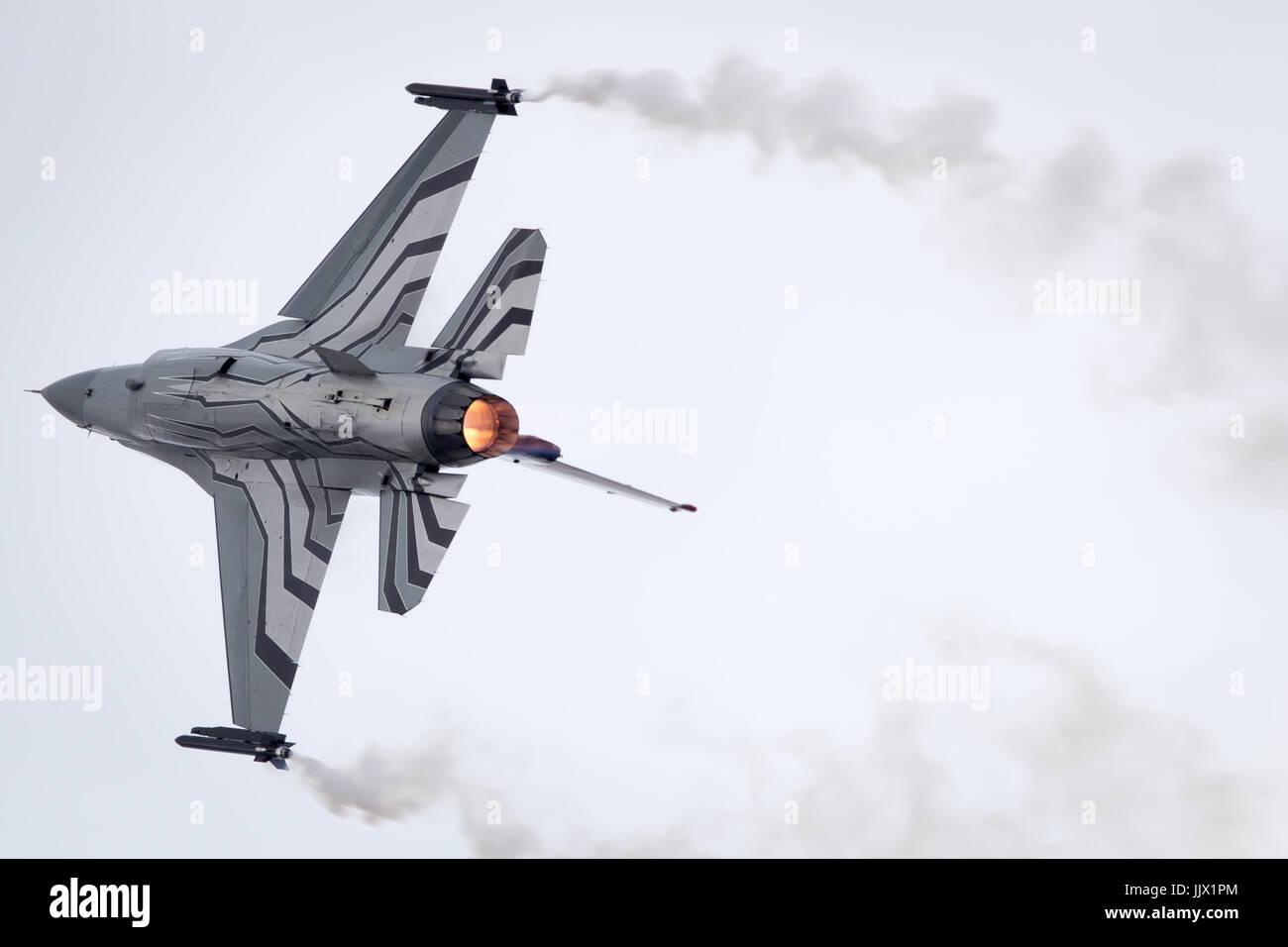Belgian Air Force Lockheed Martin General Dynamics F-16 Fighting Falcon performing its Aerobatic Display at Fairford - Stock Image