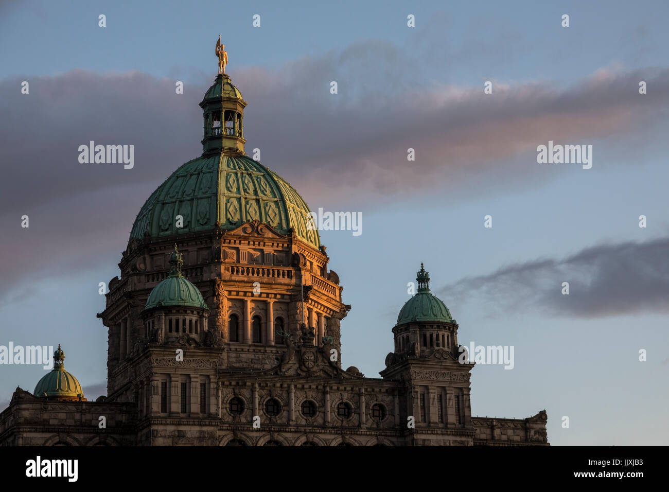 A view of the British Columbia Parliament Buildings at sunset in Victoria, BC, Canada. - Stock Image
