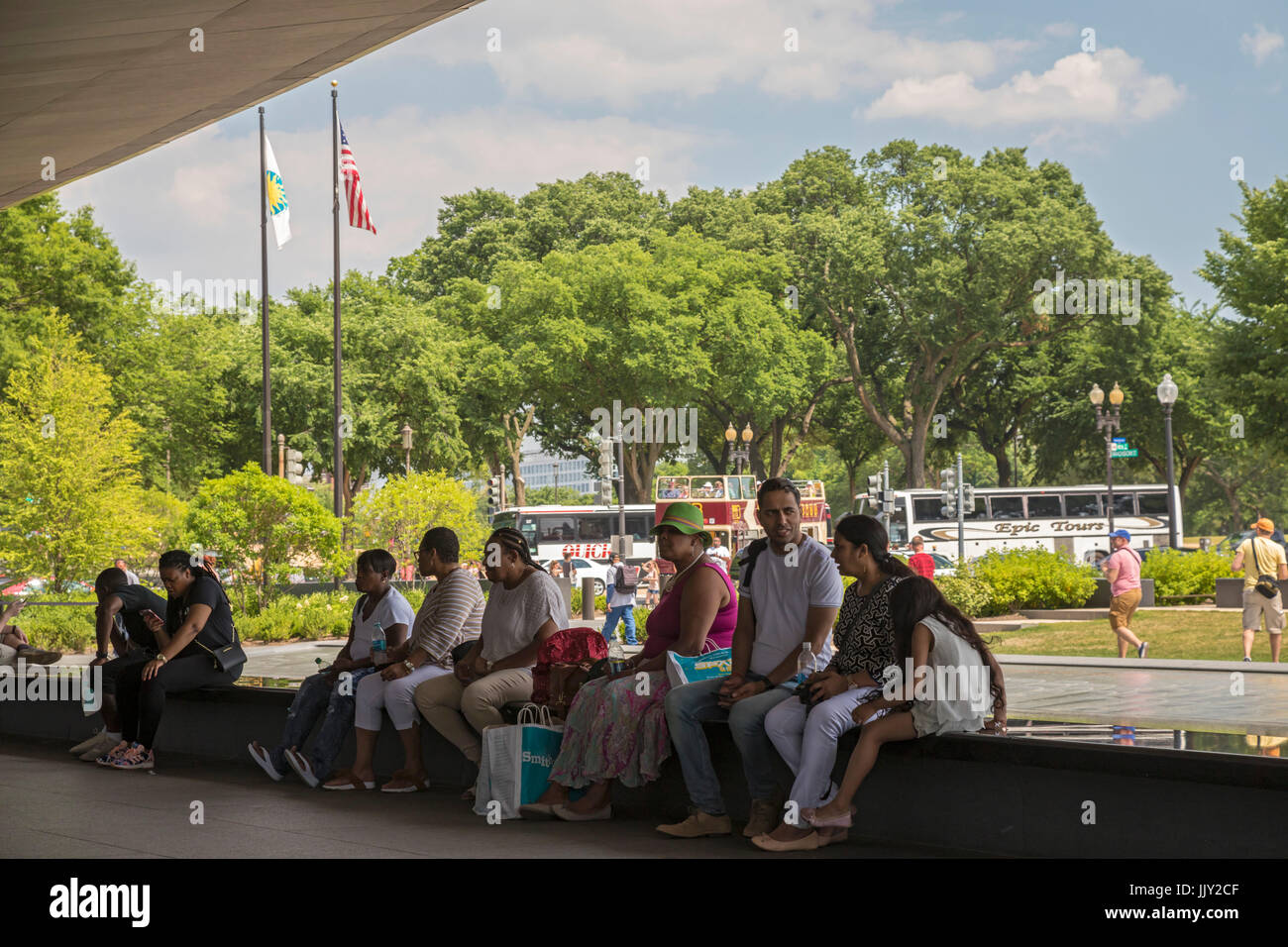 Washington, DC - Visitors to the National Museum of African American History and Culture sit by a pool outside the museum. Stock Photo