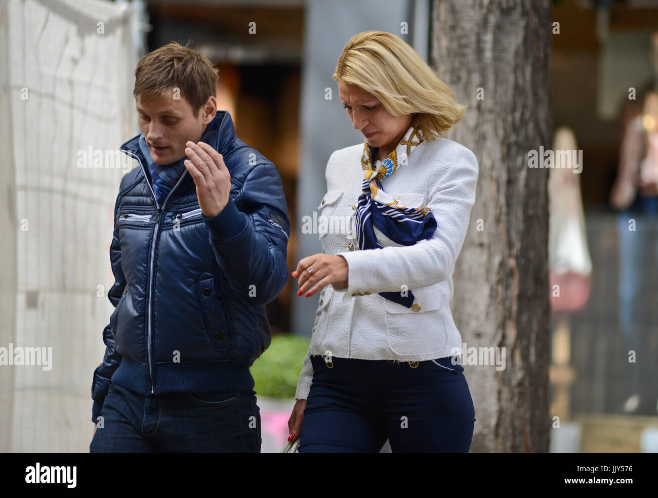 A couple arguing in the street - Stock Image