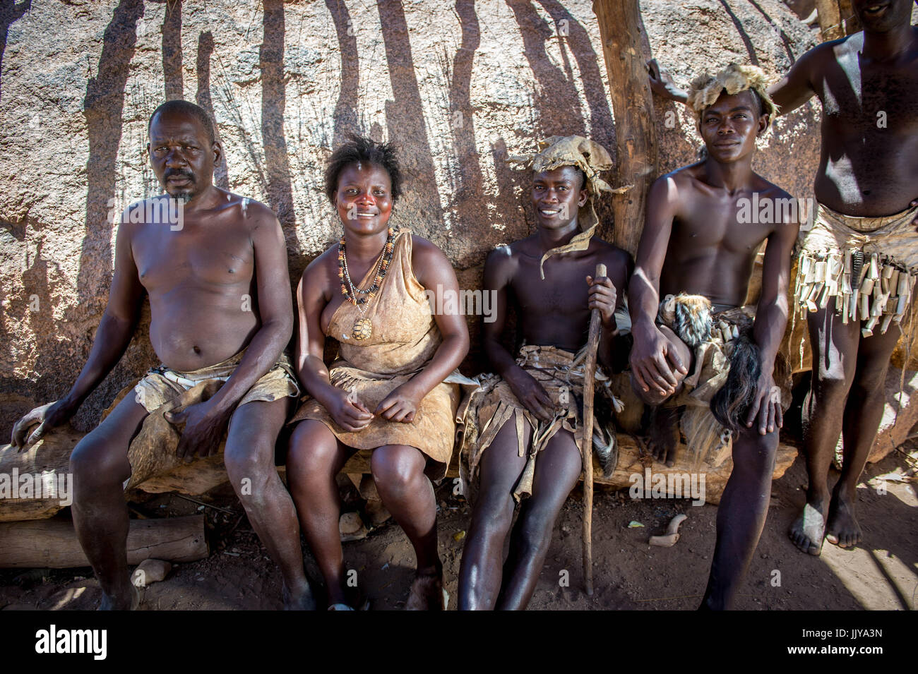 Damara men and women dressed in traditional tribal clothing pose for a photograph at the Damara Living Museum in - Stock Image