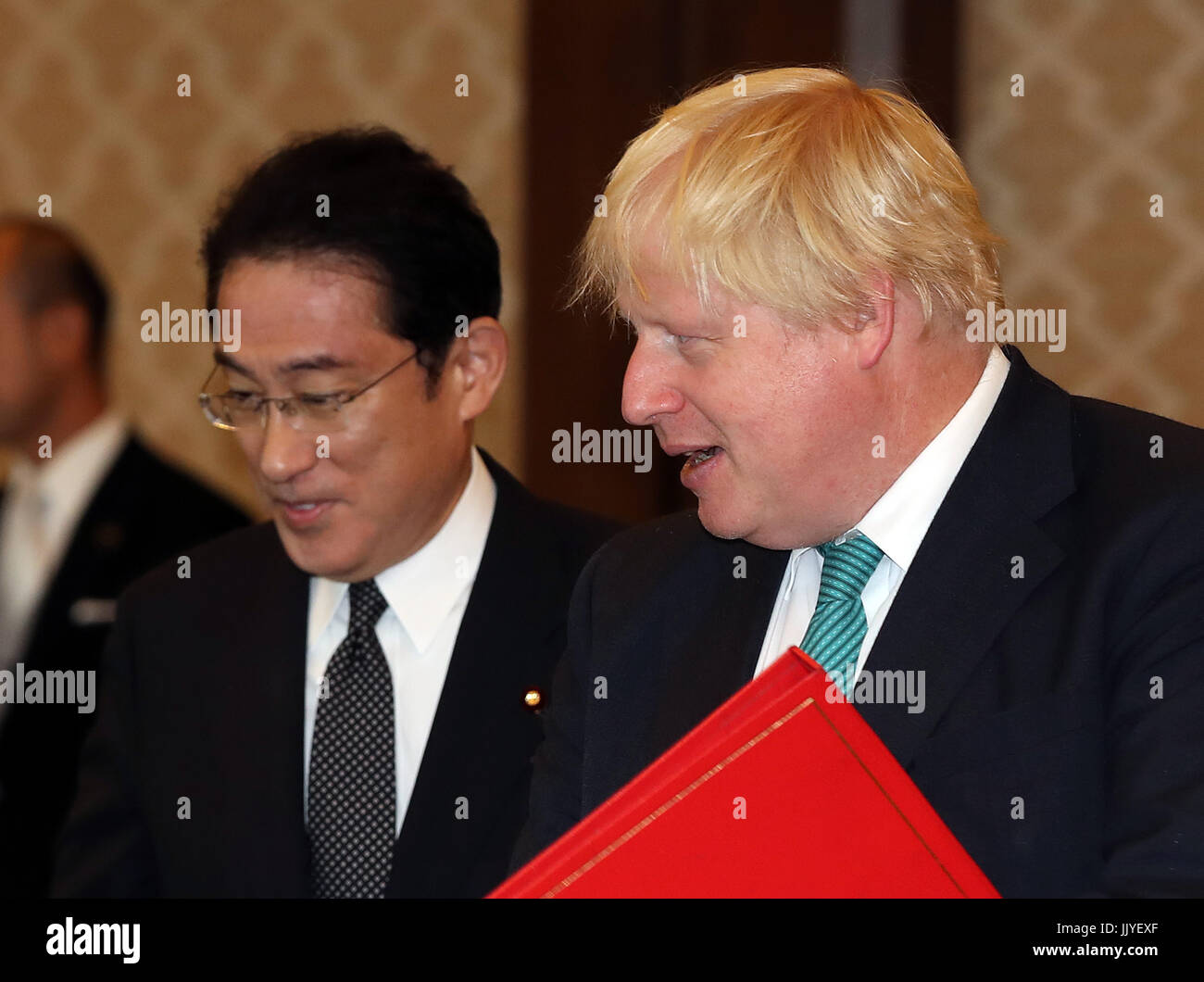 Tokyo, Japan. 21st July, 2017. British Foreign Secretary Boris Johnson (R) is greeted by his Japanese counterpart - Stock Image