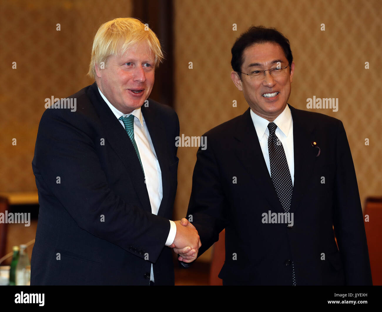 Tokyo, Japan. 21st July, 2017. British Foreign Secretary Boris Johnson (L) shakes hands with his Japanese counterpart - Stock Image