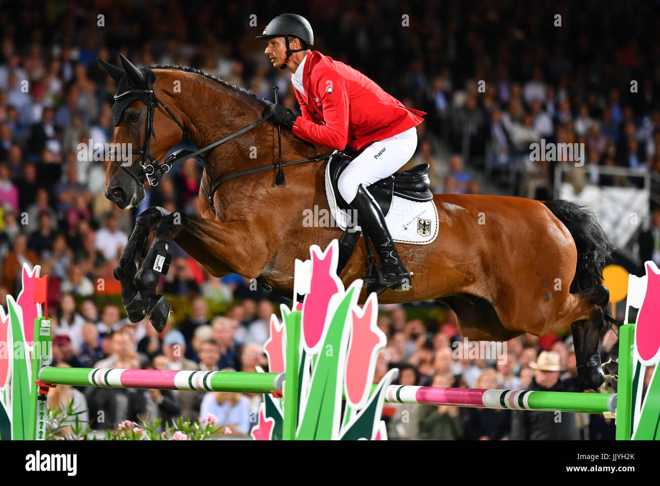 Aachen, Germany. 20th July, 2017. German show jumper Marco Kutscher riding the horse Clenur jumps over an obstacle Stock Photo