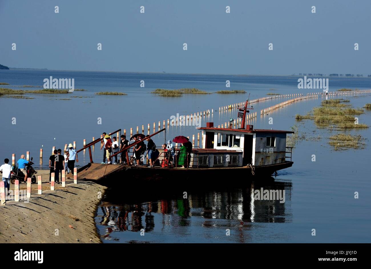 Yongxiu. 21st July, 2017. A boat conveys people at the submerged Dahuchi section of Yongxiu-Wucheng Road in east - Stock Image