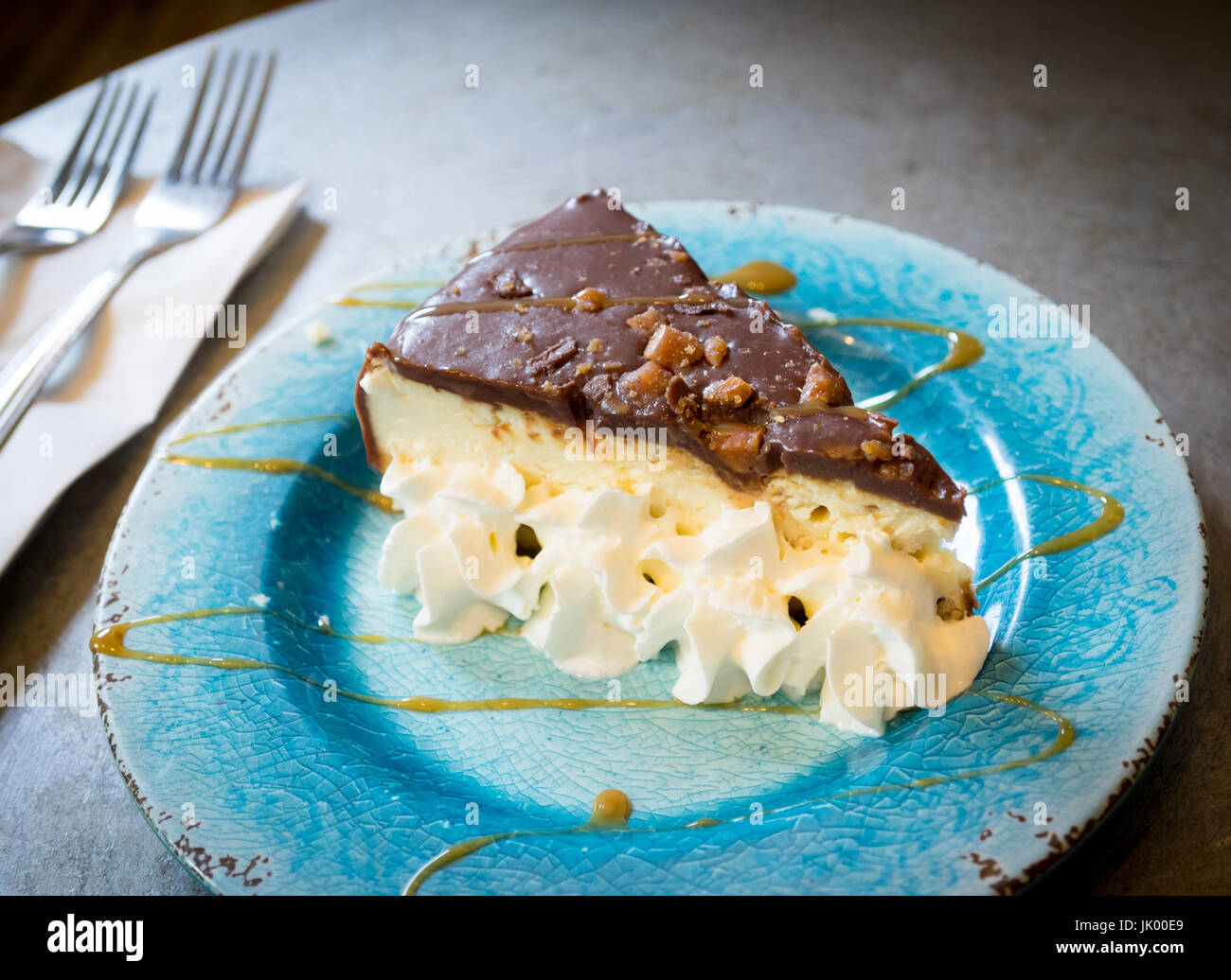 A decadent slice of s'mores cheescake from D'Lish by Tish Cafe in Saskatoon, Saskatchewan, Canada. - Stock Image