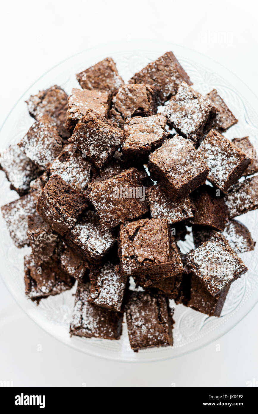 traditional chocolate fudge brownie cakes in serving tray on table - Stock Image