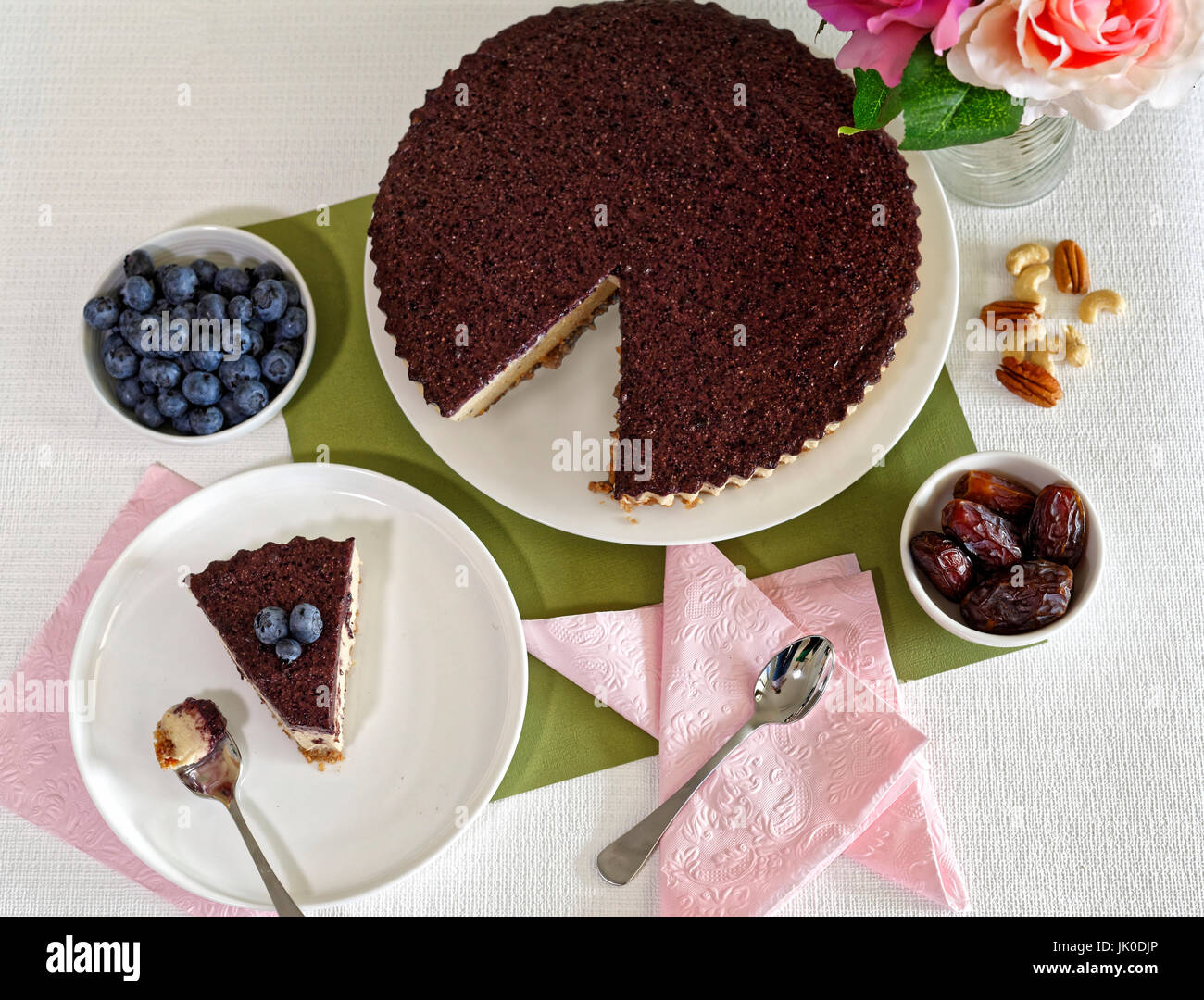 Vegan Cheesecake with blueberries, cashew nuts and dates - Stock Image