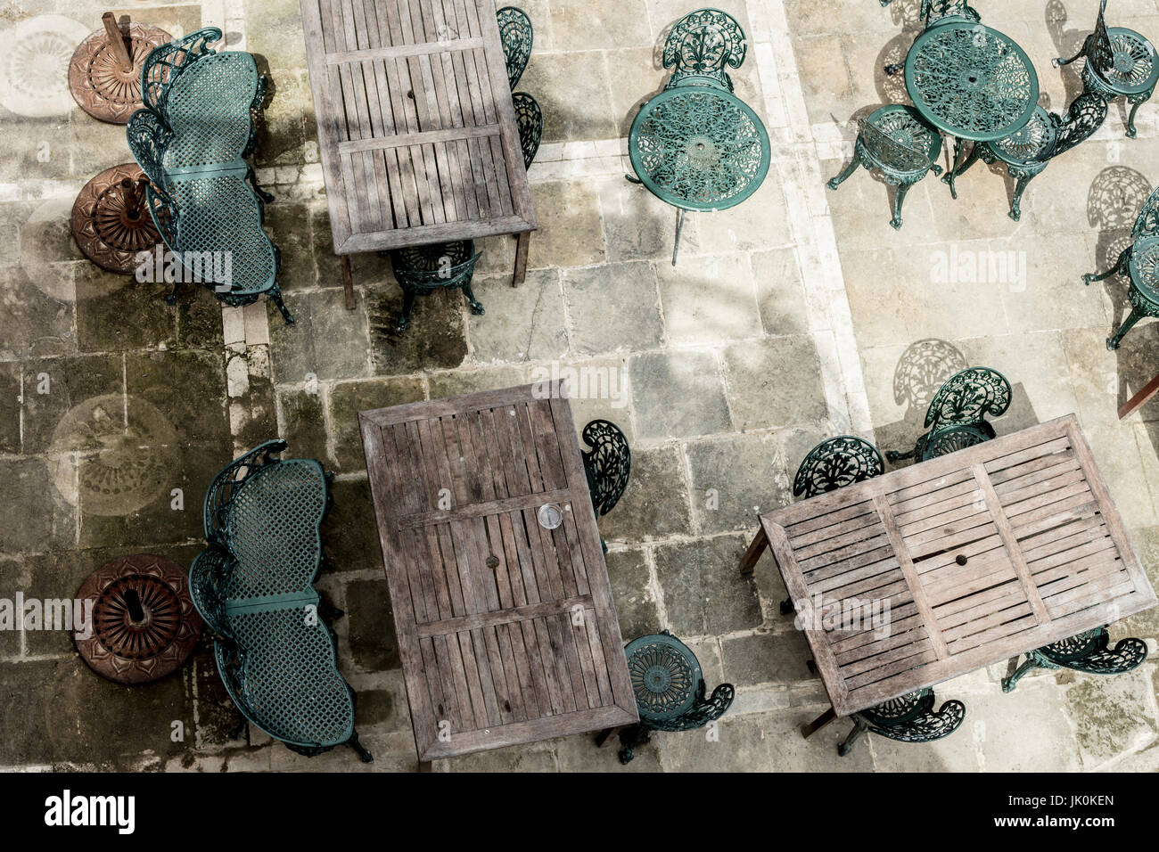 Dining tables and chairs at an outdoor restaurant - Stock Image
