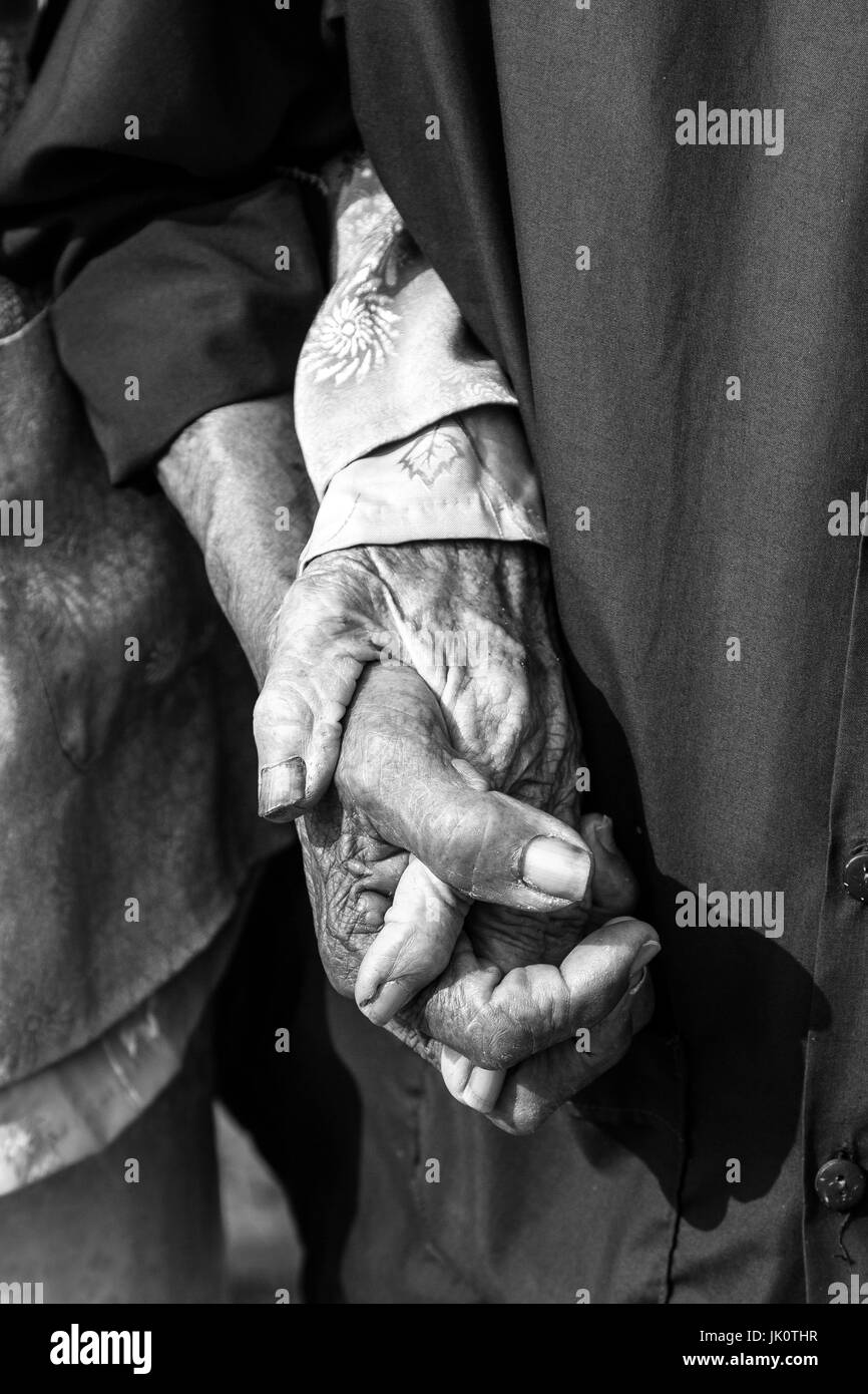 Loving old couple holding hands - Tra Que - 13 March 2017 - Stock Image