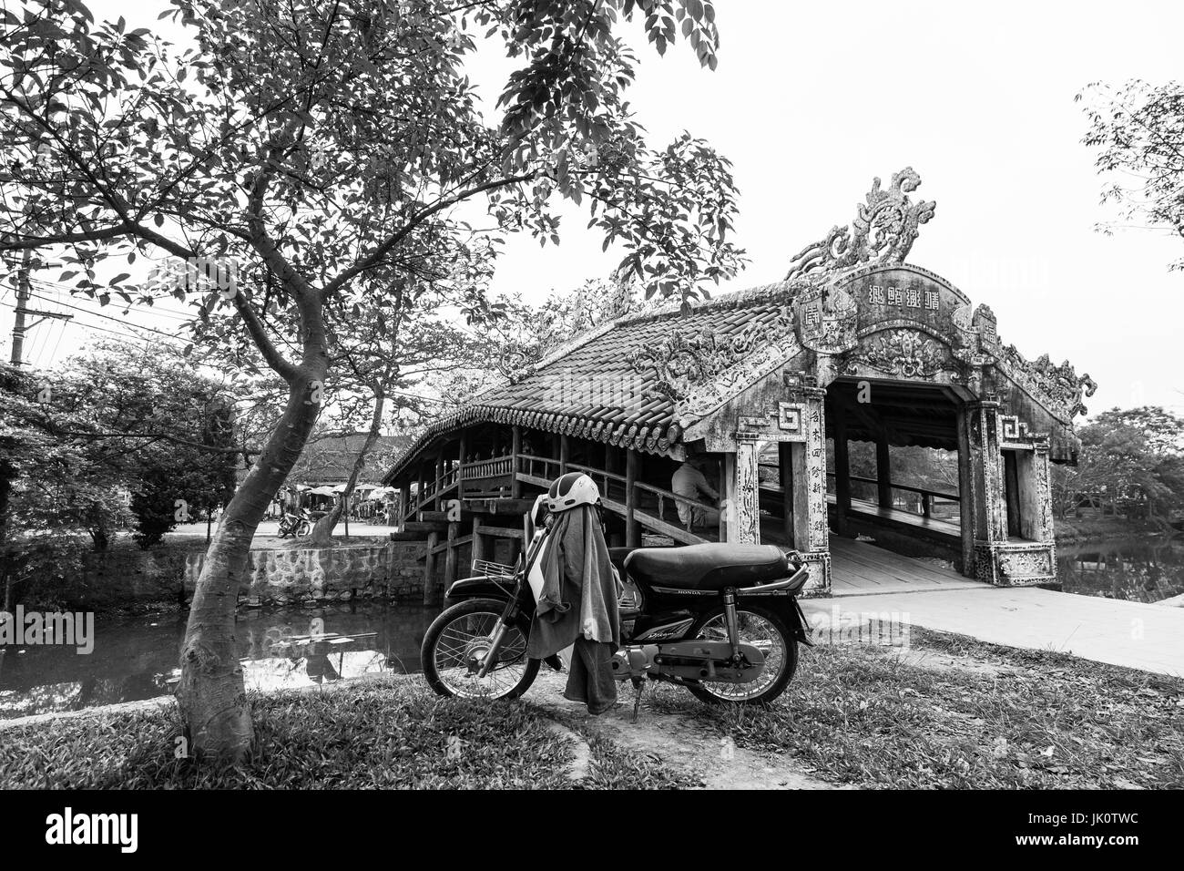 Thanh Toan wooden covered bridge in black and white - Thuy Thanh, Vietnam - March 2017 - Stock Image
