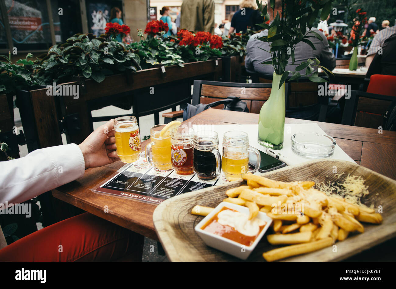 KRAKOW, POLAND - JUNE 27, 2015: Test of beer with a lots of different beers. A hand holdes a glass of beer. - Stock Image