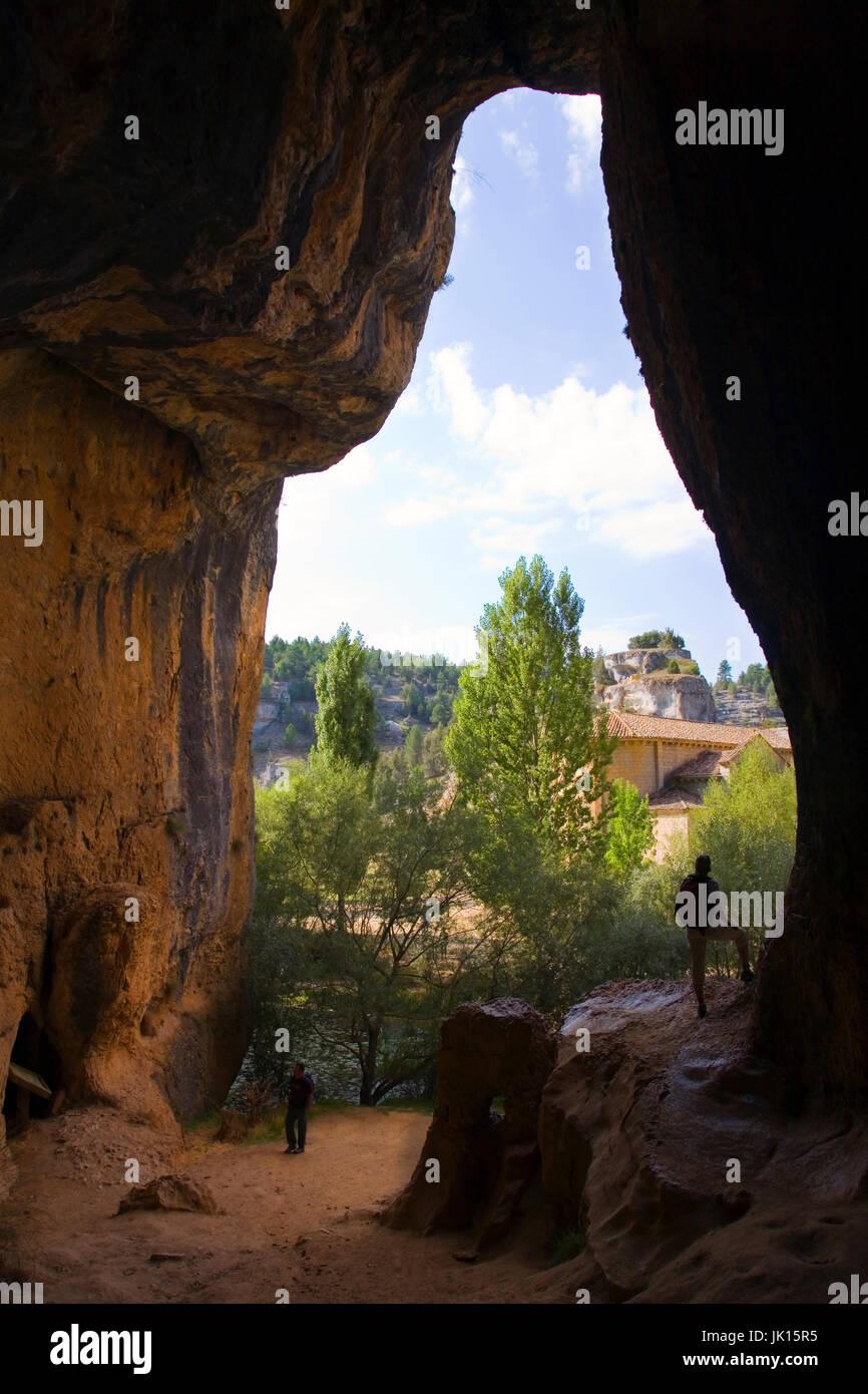 Woman in a cave and San Bartolome hermitage. Cañon del  Rio Lobos  Natural Park .  Soria province, Castilla - Stock Image