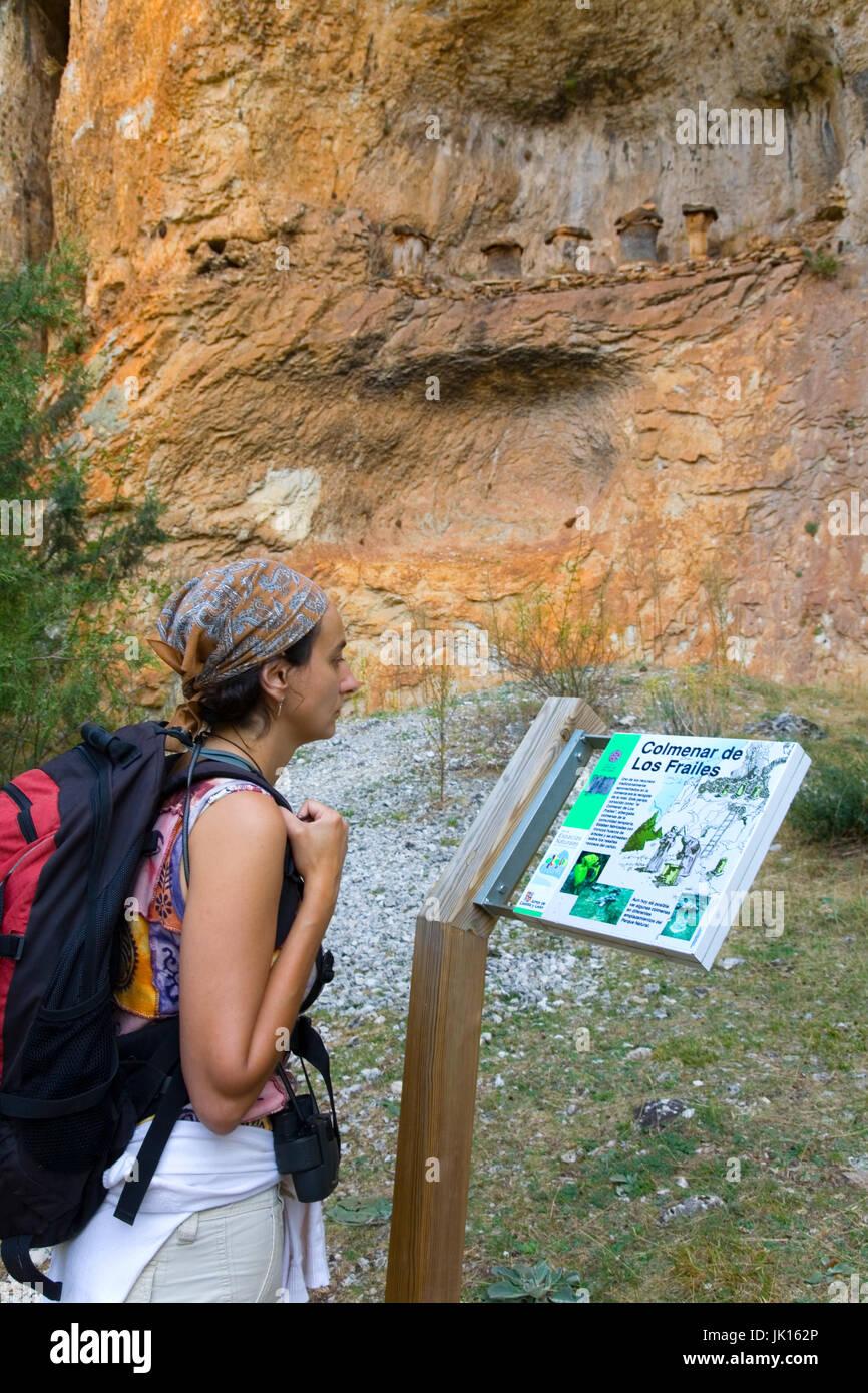 Woman watching a signal close to Beehives  (El Colmenar de los Frailes) Cañon del  Rio Lobos  Natural Park - Stock Image