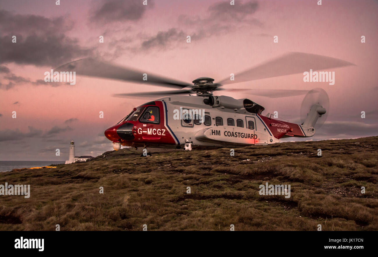 HM Coastguard Helicopter from Newquay on a training mission - Stock Image