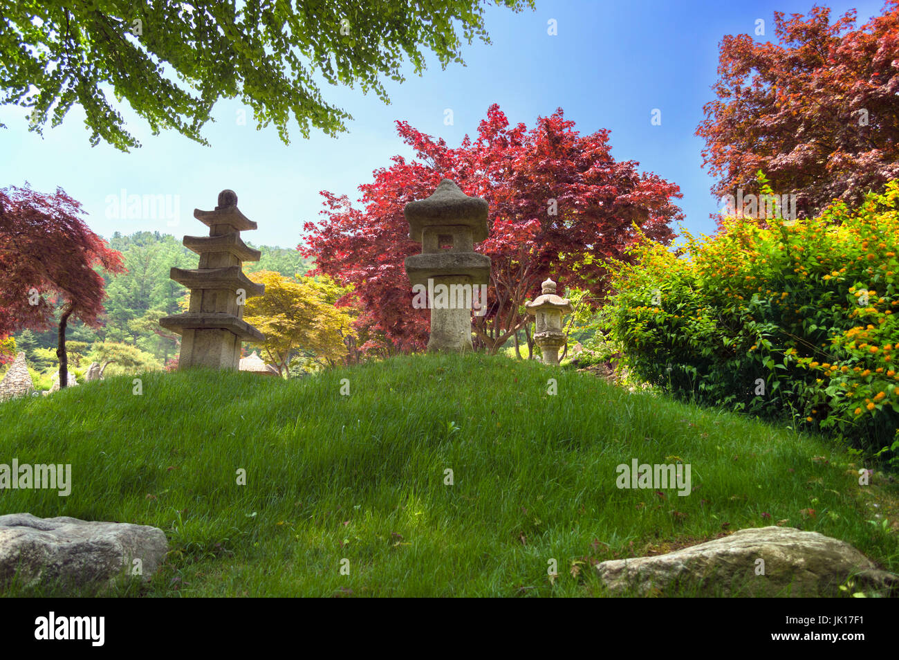 traditional korean garden with stone sculptures - Stock Image