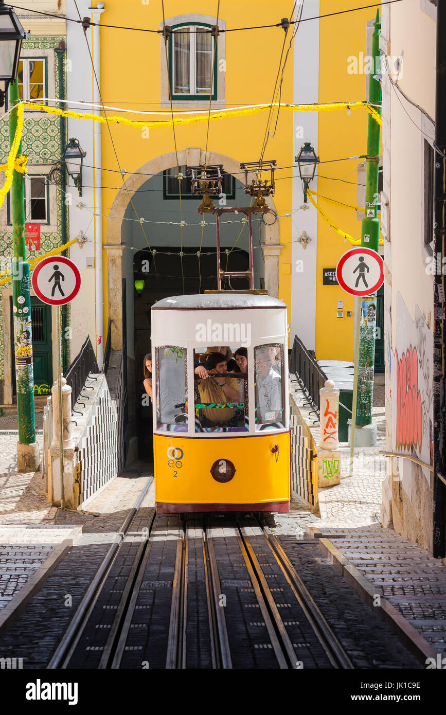 Lisbon tram, a tram carrying tourists ascends the steep Elevador da Bica in a street in the Bairro Alto district Stock Photo