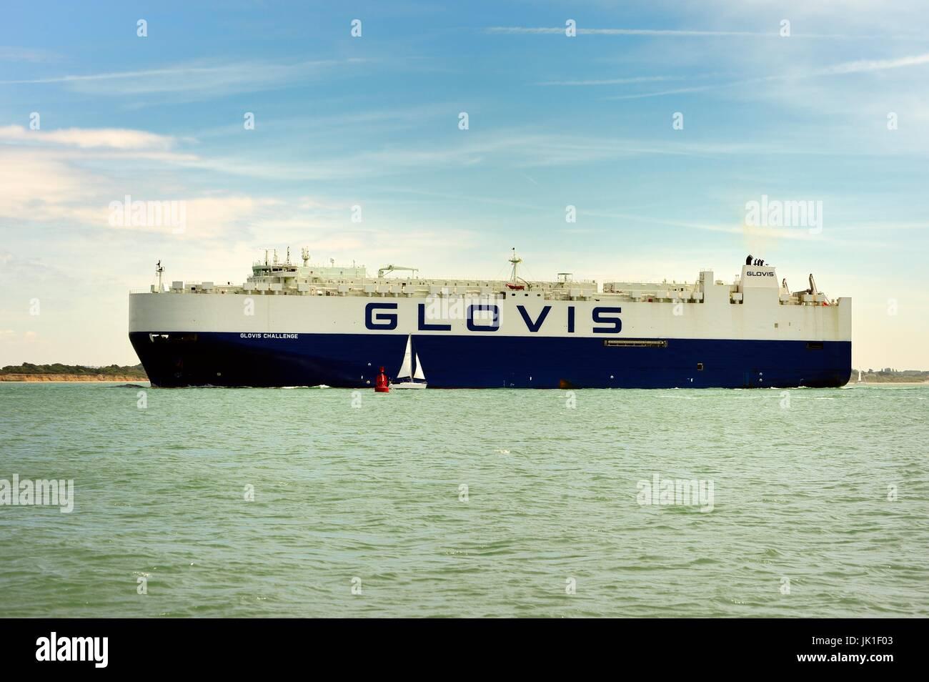 Cargo ship entering Southampton harbour - Stock Image