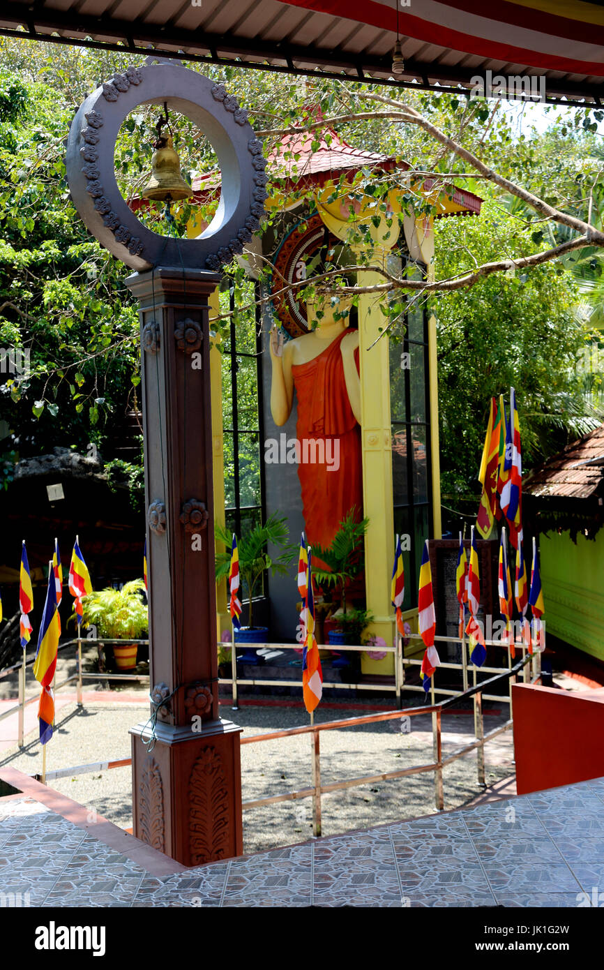 Galle Sri Lanka Rumassala Road Sri Vivekaramaya Temple Bell And Standing Buddha - Stock Image