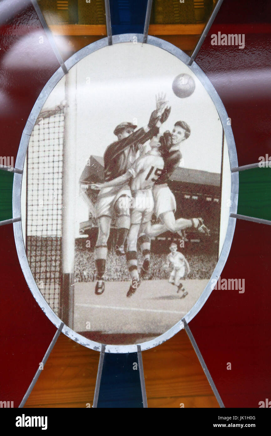 Gaelic football depicted in a pub window Stock Photo