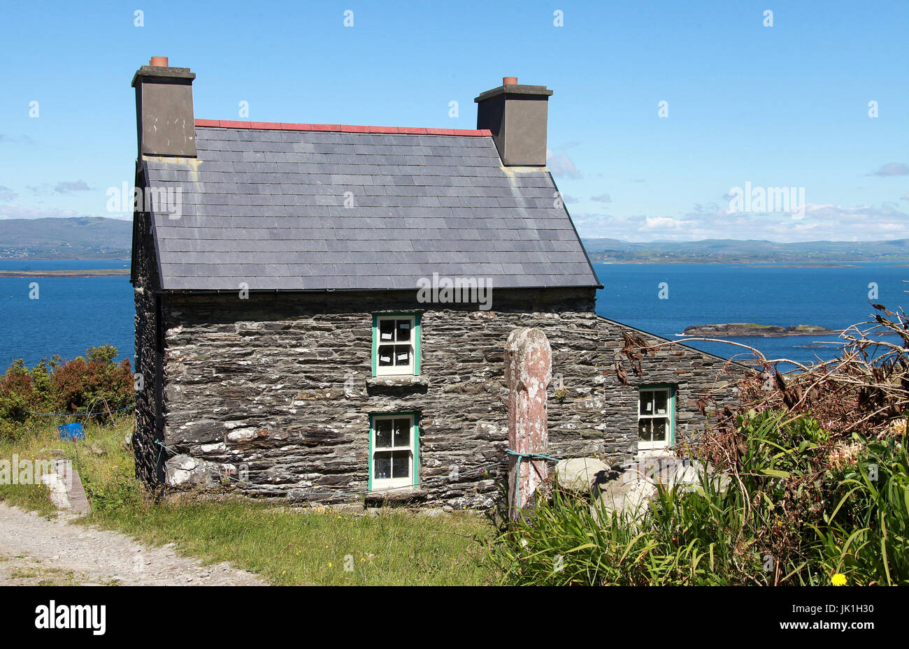 Tiny stone cottage on Cape Clear Island in County Cork - Stock Image