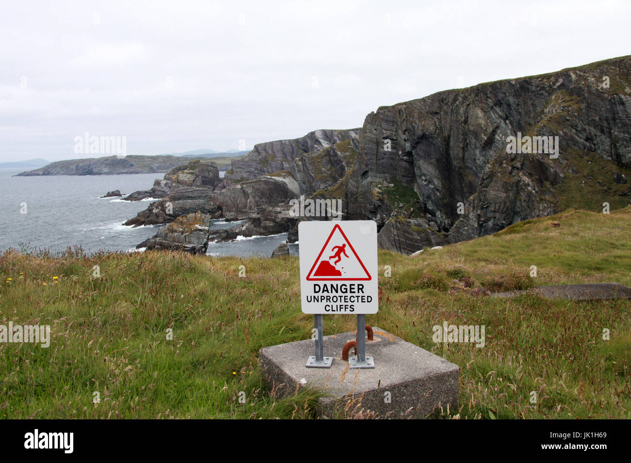 DANGER Unprotected Cliffs Sign - Stock Image