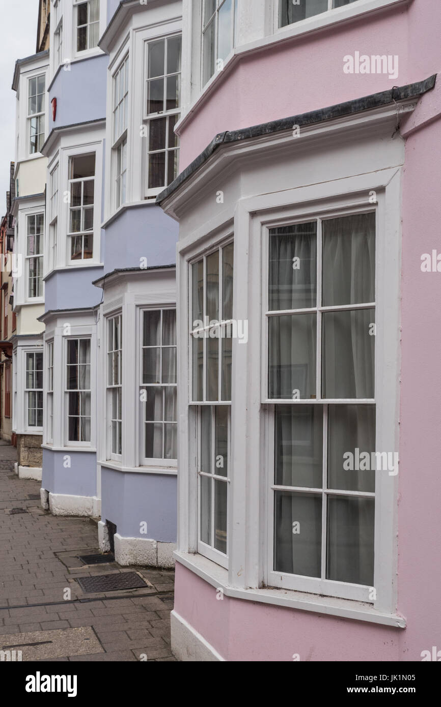 Pastel coloured Bay windows in the houses of Holywell Street, Oxford, England, UK. - Stock Image