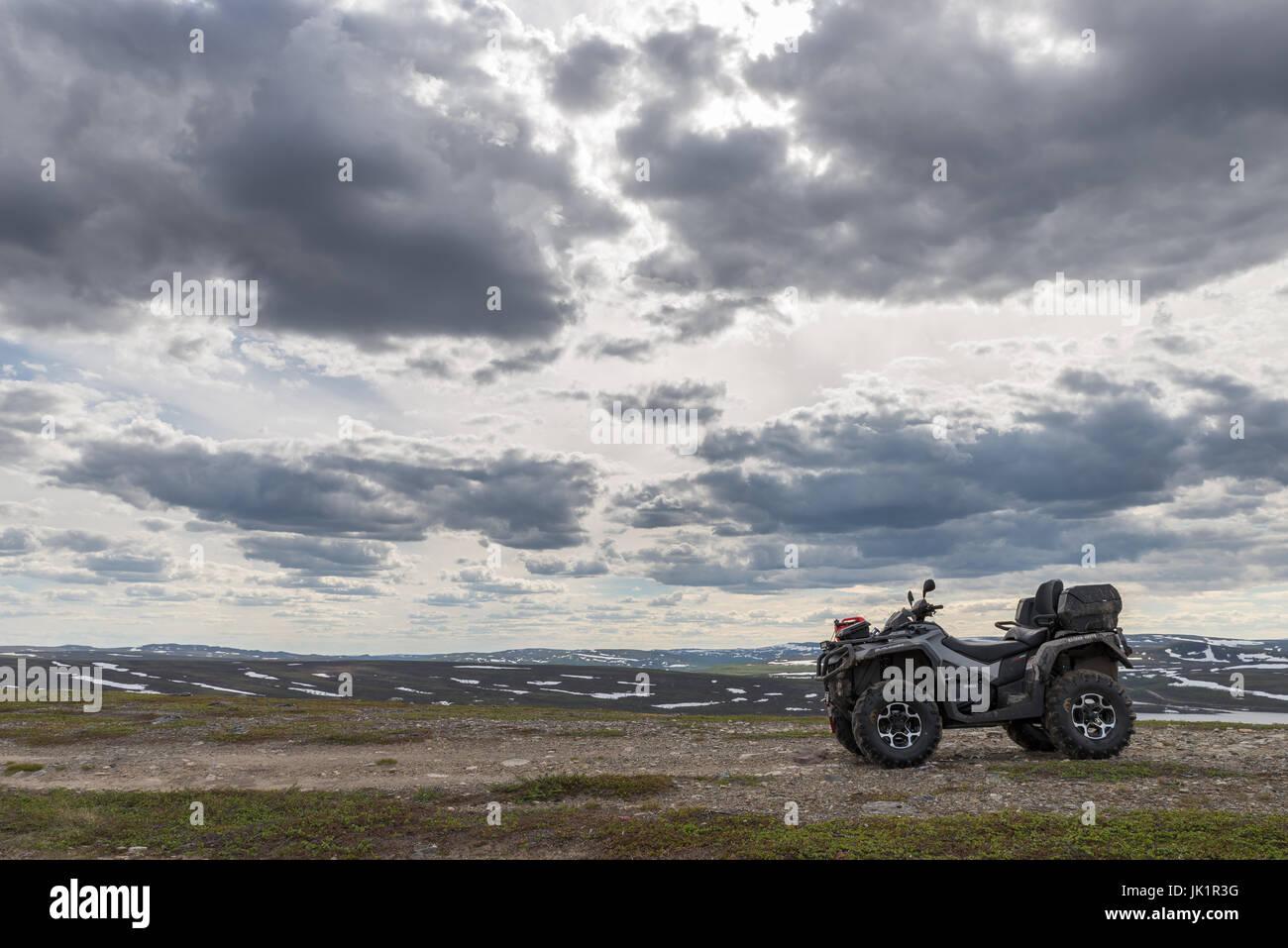 atv exploring mountain arctic Finnmark Norway - Stock Image