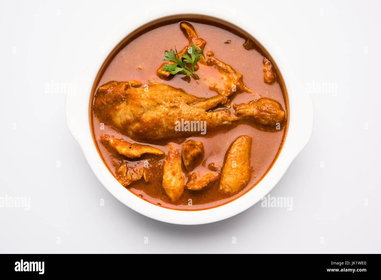 Indian spicy Chicken curry or masala chicken with prominent leg piece, popular recipe from India, selective focus - Stock Image