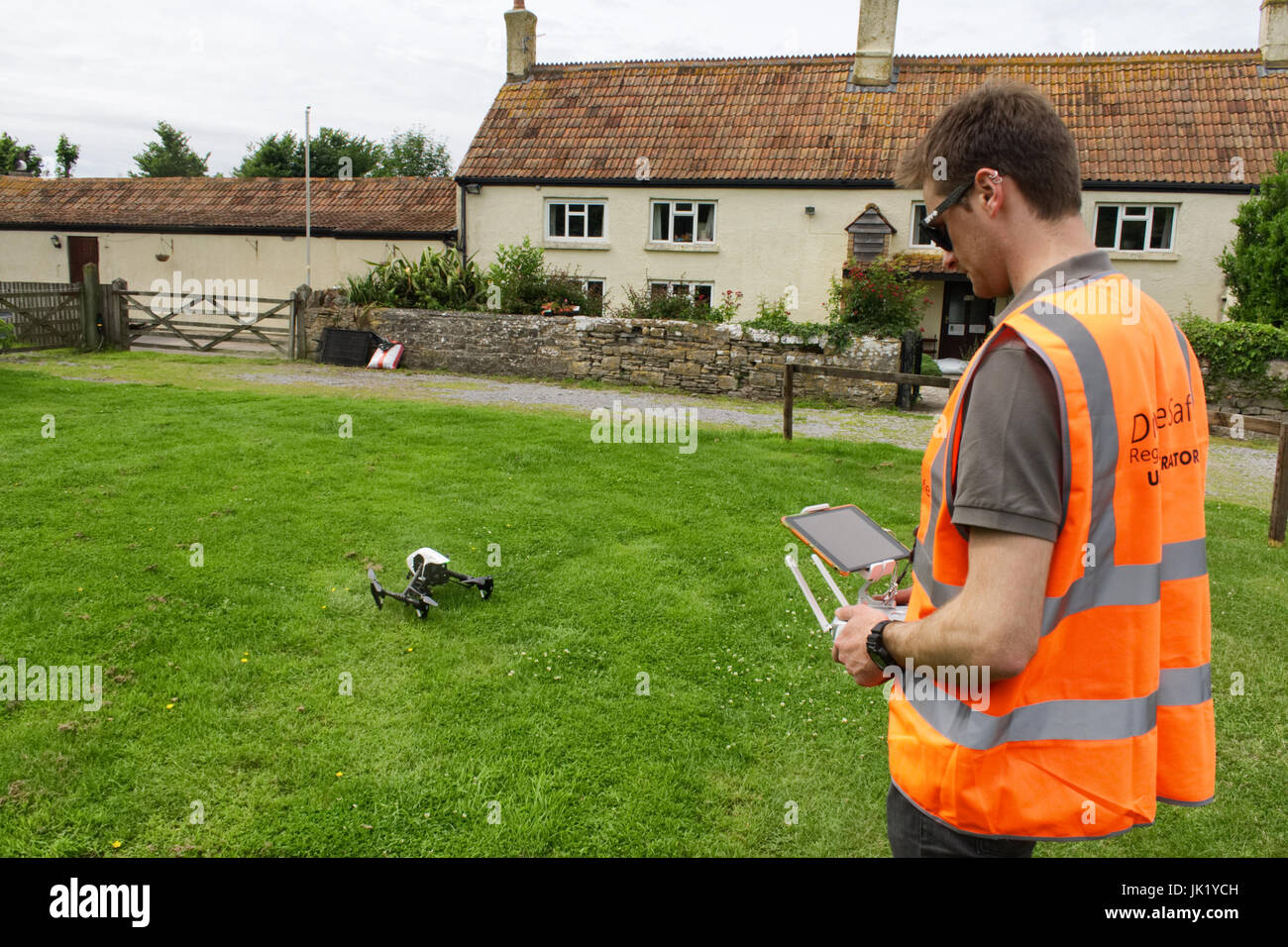 Licensed Drone Operator flying DJI Inspire 1 at a property in the UK Stock Photo