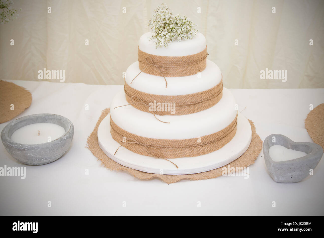 Simple White Wedding Cake with hessian fabric decoration and a white ...